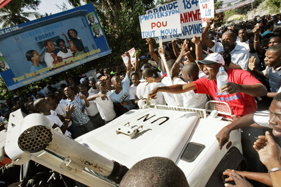 UN Mission Vehicle Blocked by Crowd in Haiti
