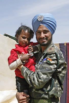 United Nations Peacekeeper Pictured with Local Child