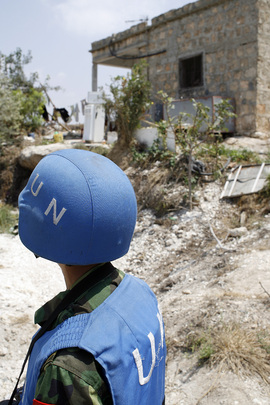 United Nations Blue Helmet Watches over Unexploded Bombs in Lebanon