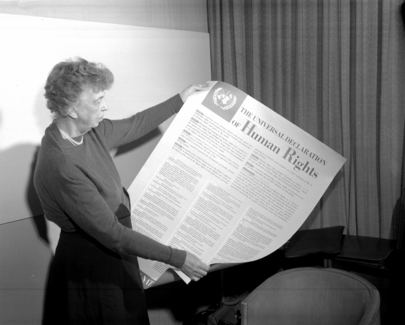 Mrs. Eleanor Roosevelt of the United States holding a Declaration of Human Rights poster in English. [November 1949]