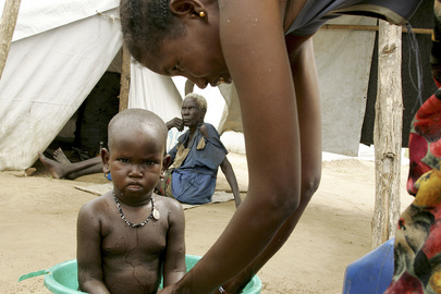 An IDP Woman Bathes Child