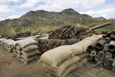 A Stockpile of Disposed Unexploded Ordinances