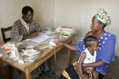 Mother Takes Child to Local Health Care Clinic in Rural Community of Senegal