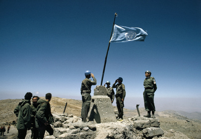 Austrian Battalion soldiers raise UN flag on Pitulim Peak on Mt. Hermon following the withdrawal of Israeli Armed Forces. 25 June 1974 Golan Heights, Syria