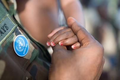 MONUC Peacekeeper Holds Child's Hand