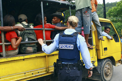 UNPOL Search Vehicles at Checkpoints in Dili
