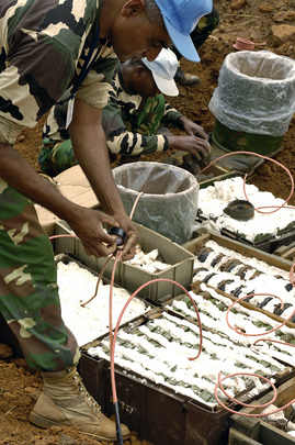 UNMIS Expert Destroys Anti-Personel Landmines