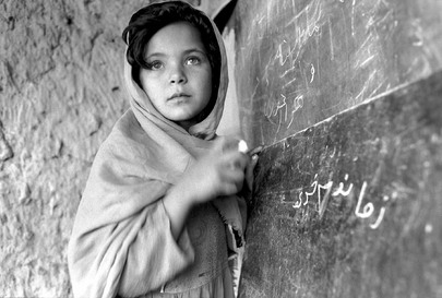 A young Afghan girl attends one of the thousands of community based schools supported by the United Nations Children's Fund (UNICEF) to make formal education accessible to children.