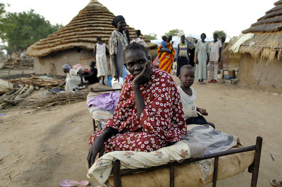 Sudanese Woman Displaced by War Seeks Shelter