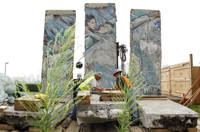 Construction Workers Relocate Berlin Wall Monument