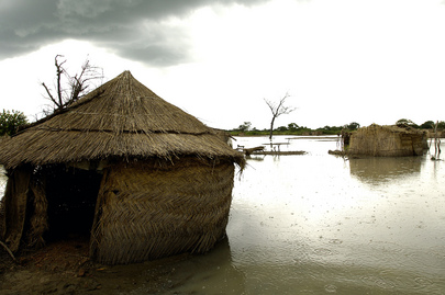 Mud Houses Surrounded by Floodwaters