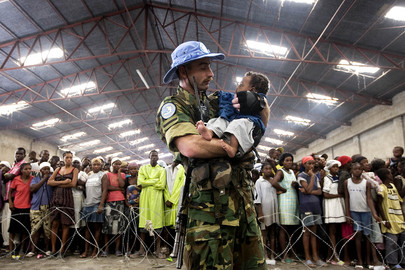MINUSTAH Military Personnel Assists Flood Victims