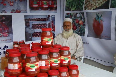 Farmer Displays Goods at Agricultural Trade Fair