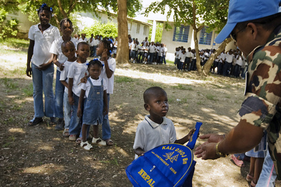 MINUSTAH Peacekeepers Distribute School Supplies to Children