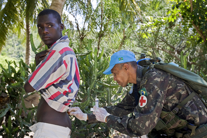 MINUSTAH Peacekeeper Administers Medical Injection to Resident