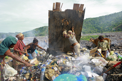 Women and Children Search for Cans to Sell