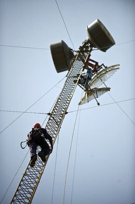 Electrical Technician Repairs Radio Tower