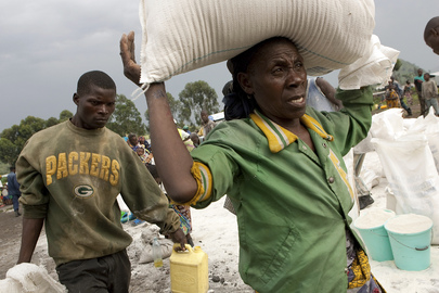 IDP Camp Residents Carry Food Rations Home