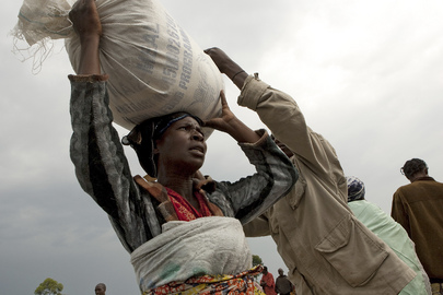 IDP Camp Resident Carries Food Ration Bag