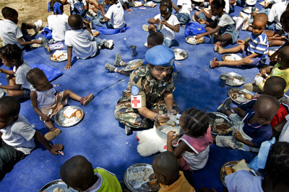 MINUSTAH Military Officer Feeds Child