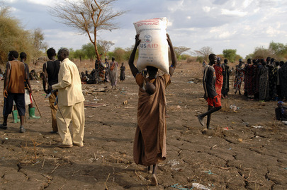 IDPs Carry Bags of WFP Food Rations