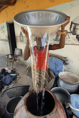 Young Girl Refills Water Pot