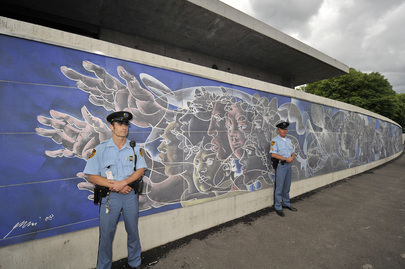 UN Security Officer Deployed on Peace Mural Security Detail