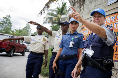 United Nations Police Officers Assist National Police Force Officers