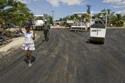 Chilean and Brazilian UN Peacekeepers Asphalt a Road