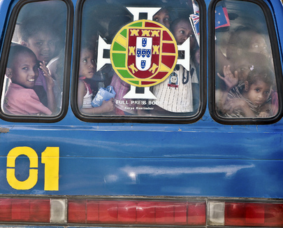 Timorese Child in Local Bus Carrying UN Flag