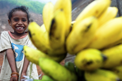 Girl Sells Bananas on Timor-Leste Roadside