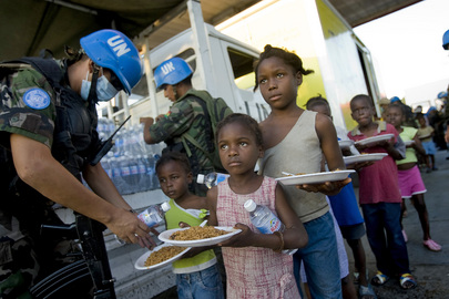 Bolivian Peacekeepers Distribute Water and Food