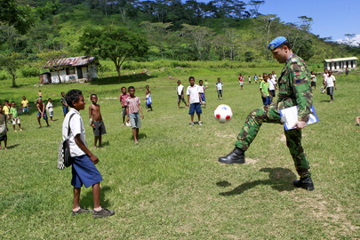 UNMIT Officer Joins in Football Game with Village Children