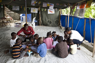 Haitian Children Play in Tent Space Six Months after Quake