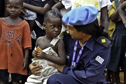 UNMIL Peacekeeper Talks with Young Girl