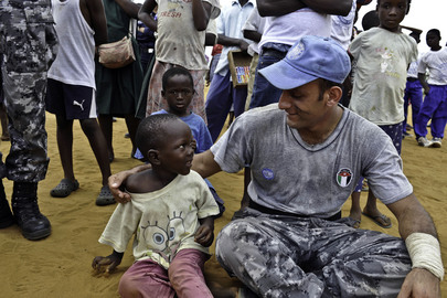 UNMIL Peacekeeper Speaks with Young Child