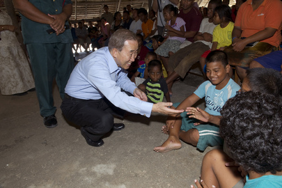 Secretary-General Ban Ki-moon greets local kids in Tebikenikora, a village on Tarawa atoll in the Pacific island nation of Kiribati.   Mr. Ban met with villagers to hear their concerns about the effects of climate change in this low-lying area. 05 September 2011 Tebikenikora, Kiribati