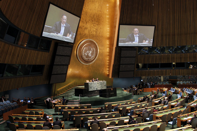 A wide view photo of the General Assembly as it considers the 2011 report of the Economic and Social Council (ECOSOC), containing highlights of the Council's work over the year. On screens is Mansour Ayyad SH A Alotaibi, Permanent Representative of Kuwait to the UN and Vice-President of the sixty-sixth session of the General Assembly. 19 October 2011. United Nations, New York.