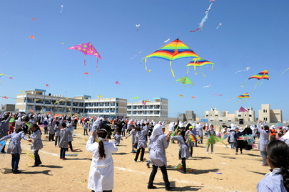 Palestinian Children Fly Kites on One-Year Anniversary of Japanese Quake