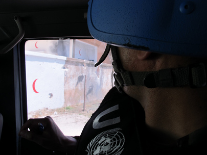 UN Observers Survey Damage after Recent Shelling in Homs