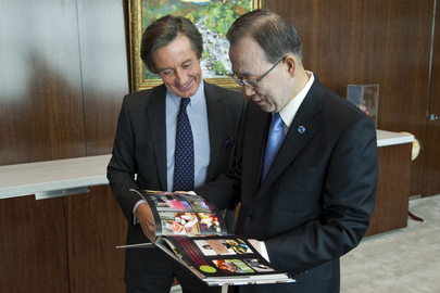 Public Information Head Presents Secretary-General with Book on Girls' Education.