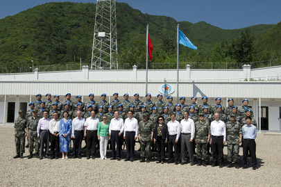 Secretary-General Ban Ki-moon (centre left, front row) visits the Peacekeeping Centre of China's Ministry of National Defense, in Huairou district, Beijing. Mr. Ban is flanked by his wife, Yoo Soon-taek (left), and Li Baodong, Permanent Representative of the People's Republic of China to the UN. 19 June 2013 Beijing, China