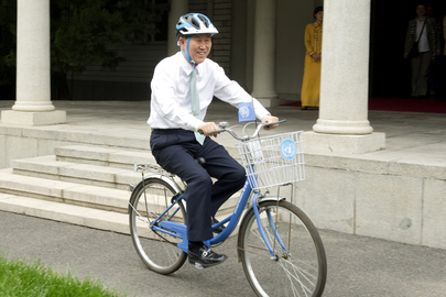 Secretary-General Ban Ki-moon takes a bicycle break during his state visit to China. 20 June 2013 Beijing, China
