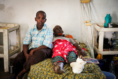Boy and Injured Father in Kismayo Hospital, Somalia
