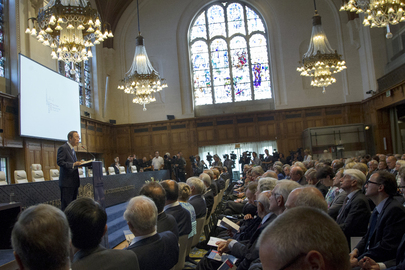 Secretary-General Ban Ki-moon (left, at lectern) speaks at the ceremony marking the 100th anniversary of the Peace Palace, seat of the International Court of Justice, in The Hague. 28 August 2013 The Hague, Netherlands