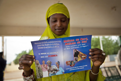 Young Woman Reads Peace Caravan flyer in Gao, Mali