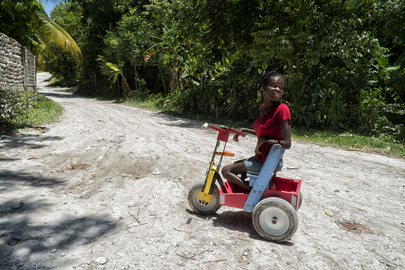 Girl with Tricycle in Les Cayes