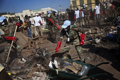 UN peacekeepers from Benin and Malians volunteer to clean up a neighborhood in Bamako, Mali.