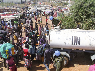 UNMISS Officers Provide Water to Civilians Seeking Refuge, Juba