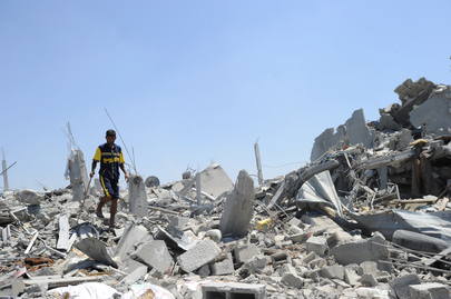 Palestinians Search through Rubble in Gaza